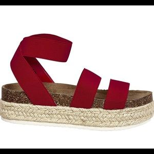 Red espadrille platforms